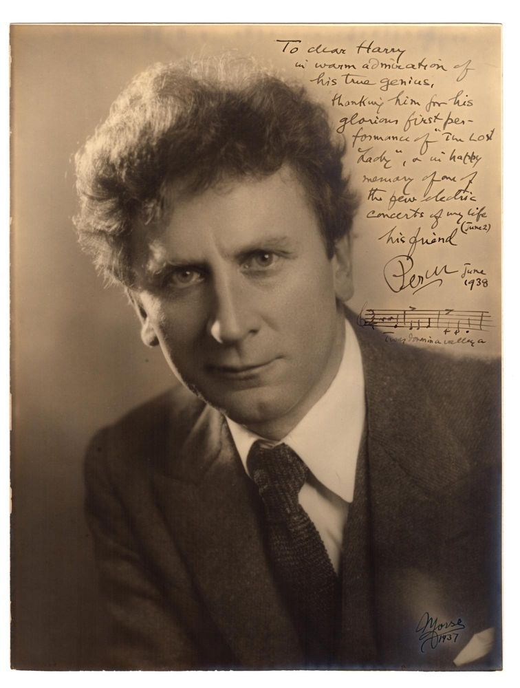 A large vintage portrait photograph of Australian-born composer Percy Grainger, signed by him with a warm inscription and musical sentiment. Percy GRAINGER.