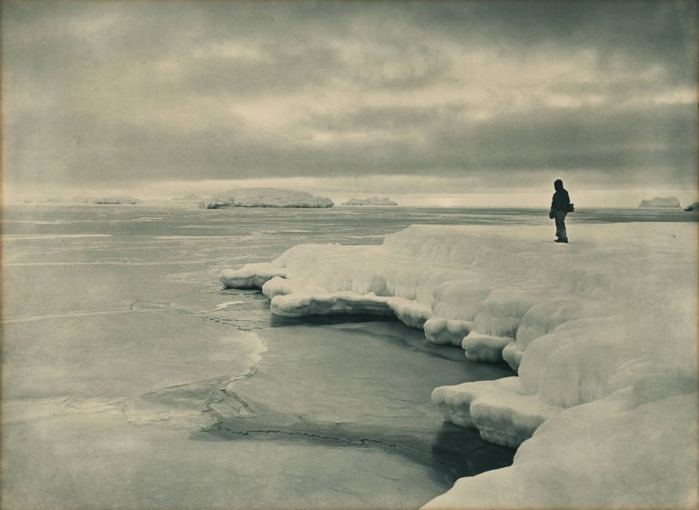 'The Pallid Glow of a Midwinter Noon at Cape Denison' [Australasian Antarctic Expedition, 1911-1914]. Frank HURLEY.