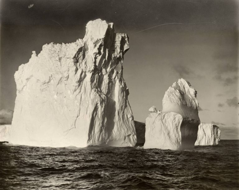 Icebergs [British, Australian and New Zealand Antarctic Research Expedition, 1929-31]. A vintage gelatin silver print (visible image size 300 × 379 mm) recently matted, framed and glazed (external dimensions 505 × 630 mm). Frank HURLEY.