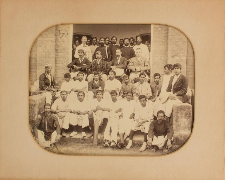 A vintage group photograph captioned 'Cricket Match Feb 02 Furreedpore' ['1902 Faridpur' in another hand on the verso]. Cricket.