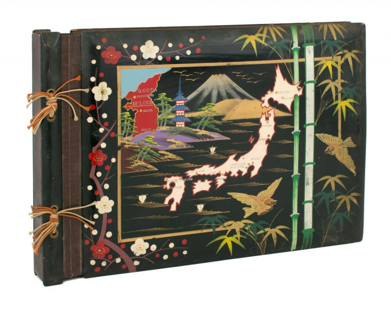 A large photograph album (275 × 390 mm) of Japanese origin and Korean War vintage, with the lacquered front cover extensively hand-decorated in colour. Japan and Korea.