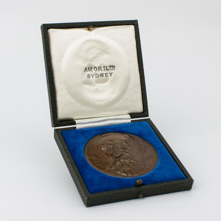The Henry G. Smith Memorial Medal for chemistry awarded to Sir Geoffrey Badger, eminent organic chemist and later Vice-Chancellor of the University of Adelaide, in 1950. The cast bronze medal was designed by Eileen McGrath (a pupil of Raynor Hoff) and produced by Amor Pty Ltd, Sydney, around 1934. Chemistry.