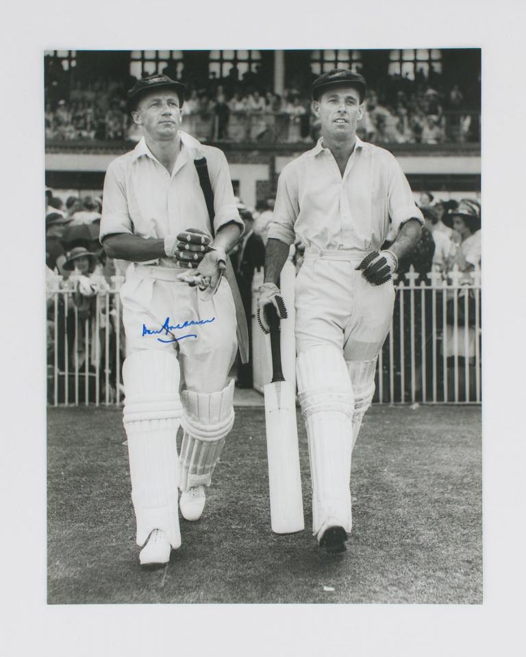 A signed photograph (black and white, 303 × 240 mm) of Don Bradman walking out to bat with Jack Fingleton. Cricket, Don BRADMAN.