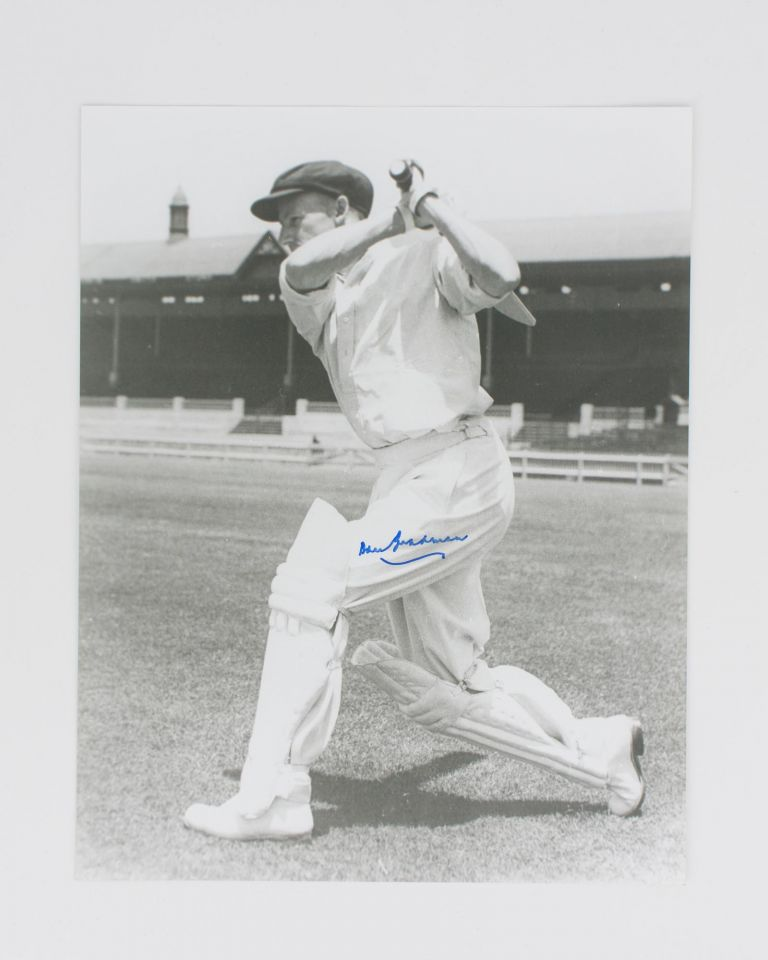 A signed photograph (black and white, 303 × 240 mm) of Don Bradman executing a cover drive. Cricket, Don BRADMAN.