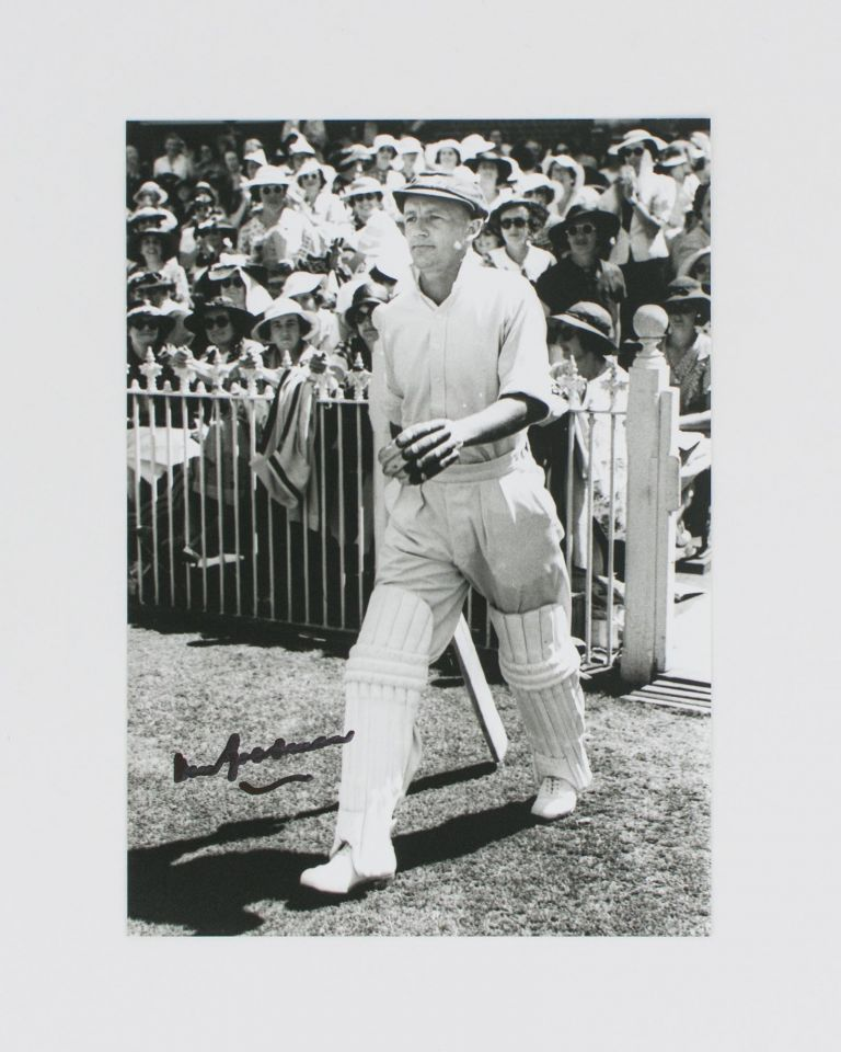 A signed photograph (black and white, 177 × 125 mm) of Don Bradman executing a cover drive. Cricket, Don BRADMAN.