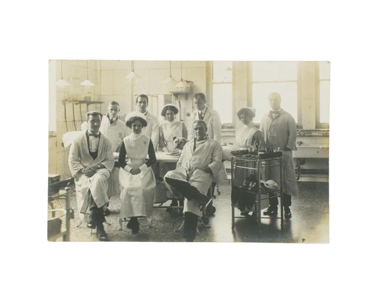 A vintage photograph of a hospital operating theatre, complete with nine doctors and nurses - and a dog. Hospitals.