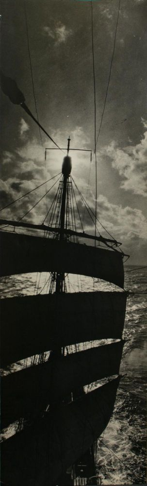 The mainmast of SY 'Discovery' silhouetted against the sun, taken from the fore topgallant yard. BANZARE, Frank HURLEY.