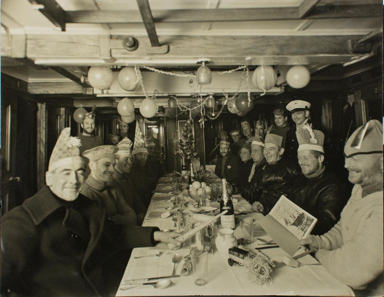 Christmas Dinner on board the SY 'Discovery', 1930. BANZARE, Frank HURLEY.