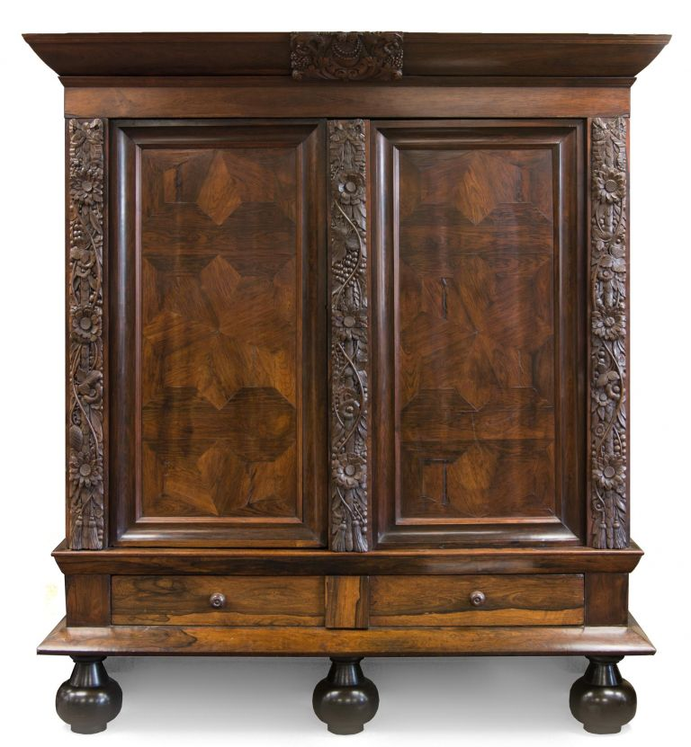 A very large and impressive Dutch rosewood veneer and carved oak 'rankenkast' ('tendril cabinet') or armoire, dating from the second half of the seventeenth century