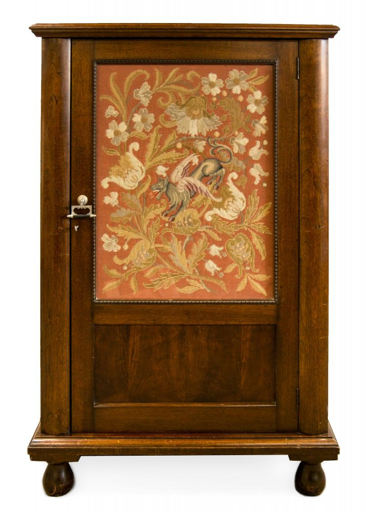 An Edwardian crystal cabinet with a large decorative panel, embroidered in gros point and petit point by Lady Paquita Mawson or her mother, Henrietta Delprat, mounted behind the original glass panel in the door