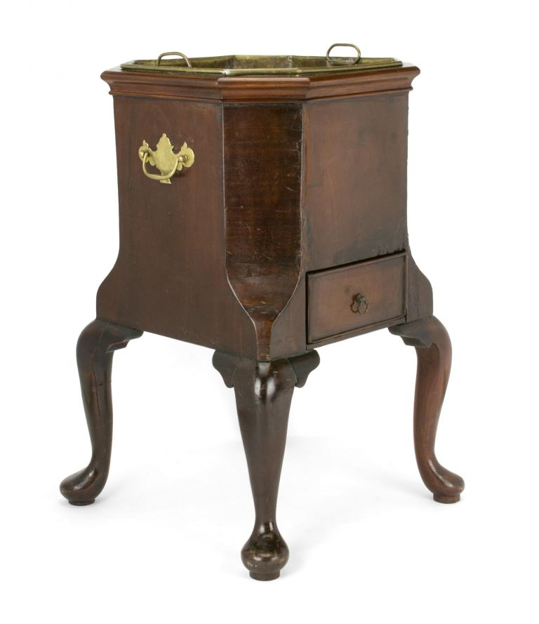 A Georgian wine cooler (circa 1750s); oak with mahogany veneer; original brass insert and hardware (the drawer pull a vintage replacement), the whole standing on four cabriole legs with pad feet
