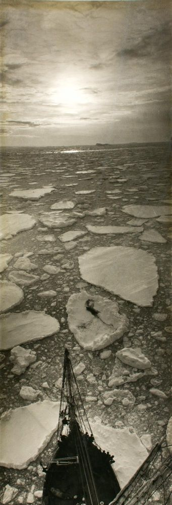 'Sunset off Proclamation'. A vintage gelatin silver photograph (482 × 174 mm) from the BANZARE voyages, 1929-1931. BANZARE, Frank HURLEY.