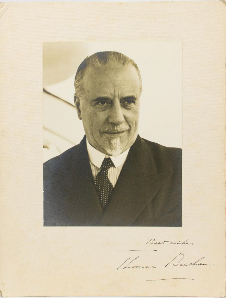A large-format vintage photograph, inscribed and signed on the mount ('Best wishes, Thomas Beecham'). Sir Thomas BEECHAM, 2nd Baronet, English conductor and impresario.