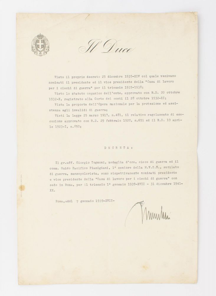 A typed document signed 'Mussolini' ('Roma, addì 7 gennaio 1939-XVII-'), reappointing two wounded veterans as President and Vice President of the 'Casa di lavoro per i ciechi di guerra' (Workhouse for the War Blind, which opened in 1931). Prime Minister of Italy, Fascist dictator - 'Il Duce' - from 1925.