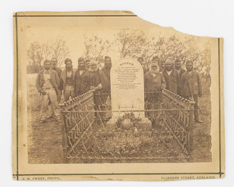 A vintage full-plate albumen paper photograph (163 × 220 mm) of a group of fourteen Ngarrindjeri [Narrinyeri] men at the graveside of the Reverend George Taplin at Point McLeay, South Australia. Captain Samuel White SWEET.