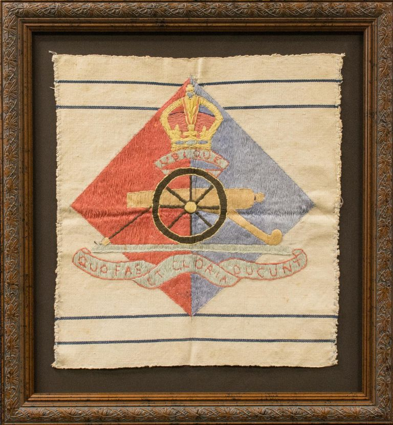 'Ubique. Quo Fas Et Gloria Ducunt' ['Everywhere. Whither Right and Glory Lead']. A piece of canvas embroidered with the badge design and motto of the Royal Australian Artillery. Royal Australian Artillery.