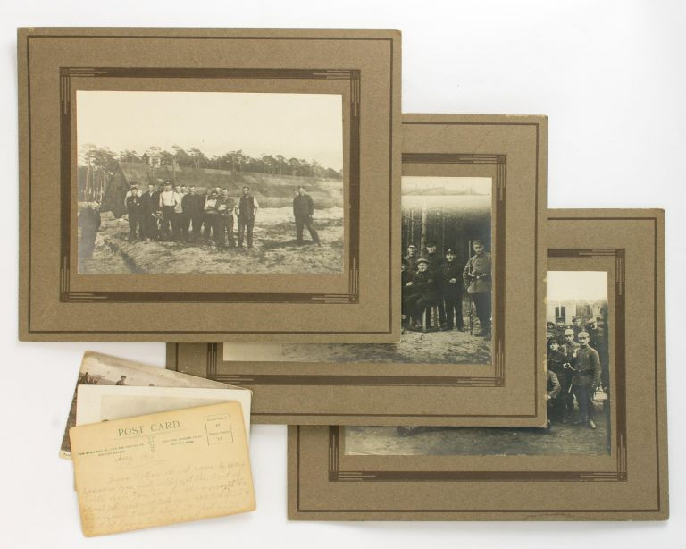 A Prisoner of War repatriation notice and four photographs relating to 1690 Private Ernest Herbert Murray Leonard. Prisoner of War, Ernest Herbert Murray LEONARD.
