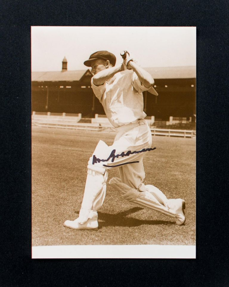 A signed photograph of Don Bradman executing a cover drive. Cricket, Don BRADMAN.