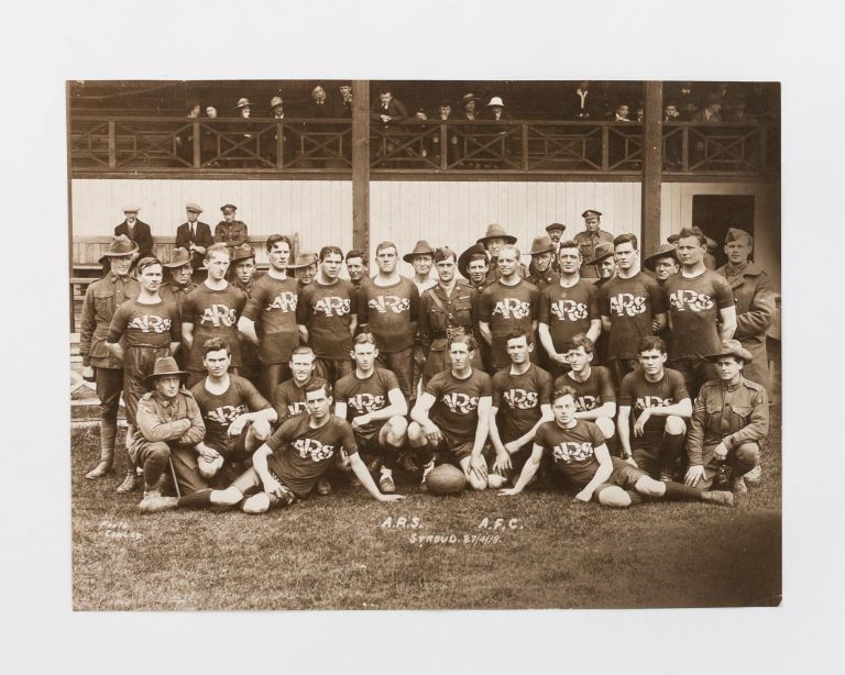 A vintage photograph (captioned in the negative 'ARS. AFC | Stroud 27/4/18' and 'Photo | Comley'), featuring a team of rugby players wearing ARS-branded jerseys, with Australian servicemen in uniform behind them. Aviation, Australian Flying Corps.