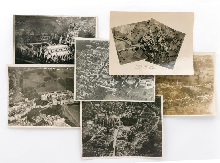 Six aerial photographs (five of them oblique) of identified cities or landmarks in England, five of them dated between September and November 1918. Aviation.