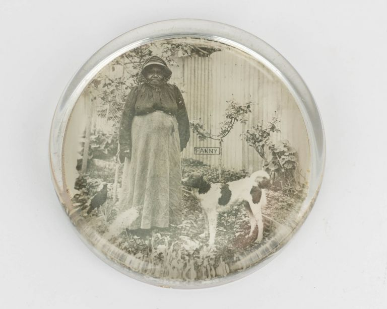 A glass paperweight featuring a photographic portrait of Fanny, an Indigenous Australian woman. Indigenous Australian Portraiture.