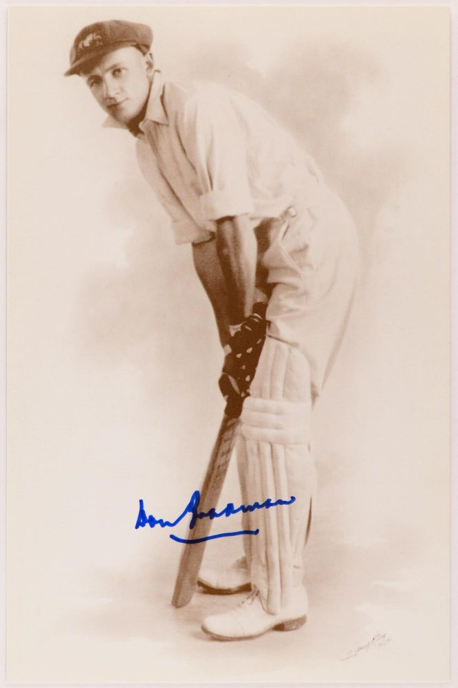 A large-format printed postcard (160 × 115 mm) of Don Bradman, based on a 1928 photograph in the State Library of South Australia's Bradman Collection. It is a high-quality reproduction of a studio portrait of a very young Don in a batting stance, wearing an Australian cap. This example, signed in ink by Don Bradman, is in fine condition. Cricket, Don BRADMAN.