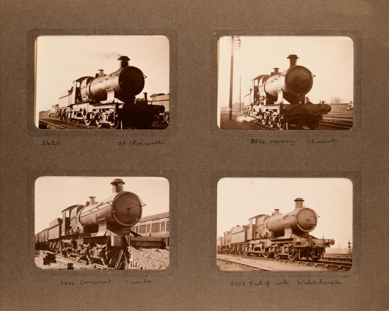 An album of photographs of British steam trains. The cloth-bound album (200 x 275 mm) contains 96 original gelatin silver photographs (each 62 x 85 mm) loosely inserted four-to-a-page behind window mounts on 12 double-sided leaves. An original photograph, trimmed to approximately 40 x 60 mm, has been mounted on the front cover. All bar 12 photographs are identified or captioned in some way in ink on the mount below the image. British Steam Trains, P. M. ALEXANDER.
