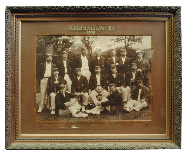 '1902 Australian XI'. A superb vintage gelatin silver photograph by Thomas Bolland of London (a gigantic 440 × 600 mm, glazed, with the original calligraphic mount and ornate frame) of the entire fourteen-man squad to tour England. Cricket.