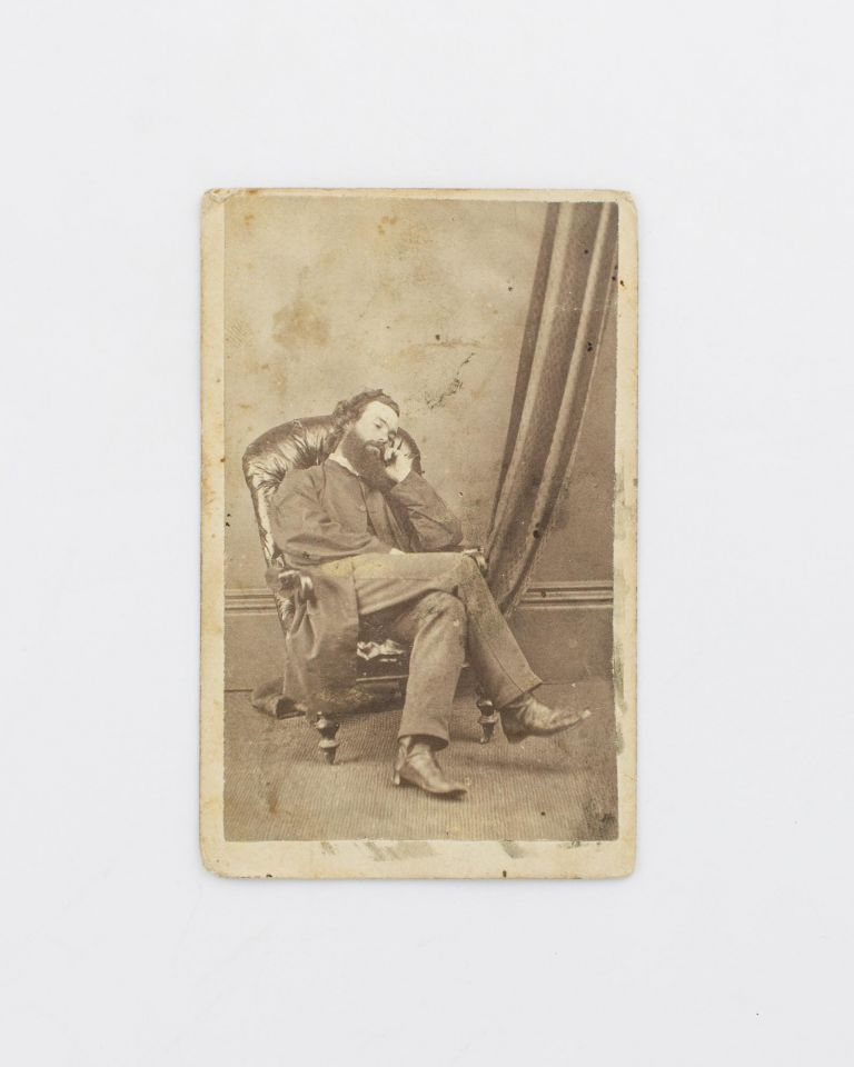 A carte de visite self-portrait, depicting the photographer 'dozing' peacefully in a high-backed padded armchair. Bernard GOODE.