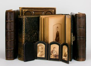 A collection of six nineteenth century photograph albums containing nearly 300 portraits of three...