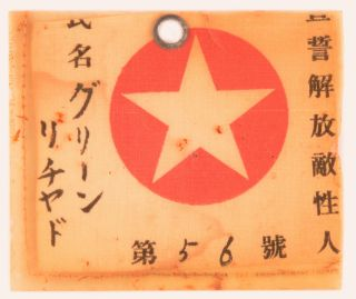 The identity tag or pass of one Richard Green, a prisoner-of-war of the Japanese during the...