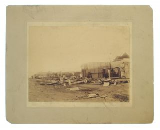 Three large albumen paper photographs, captioned in ink on the verso of each mount 'Palmerston, Port Darwin, NT, destroyed by Tornado, December, 1896'