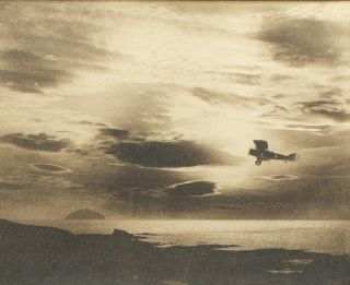A striking sepia-toned photograph of a Bristol F.2B biplane piloted by pioneering Australian aviator Captain Harry Butler while on an anti-submarine patrol off the coast of Scotland in late 1917 or 1918. At the time Butler was fighting-instructor at the Royal Flying Corps School of Aerial Gunnery and Fighting at Turnberry (now a Trump golf resort)