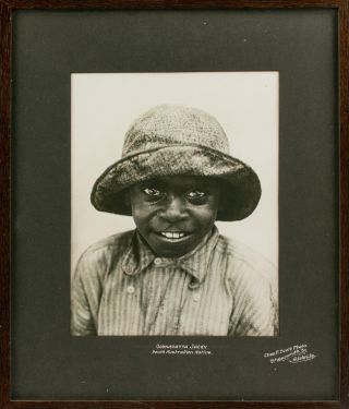 'Oodnadatta Jacky - South Australian Native'. A charming vintage portrait photograph of a young...