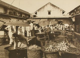 'A Javanese Market Place'. A vintage sepia-toned carbon print on the original flush-cut thick card mount. Frank HURLEY, Australia.