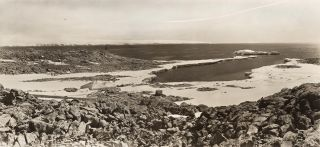 A panoramic view of Cape Denison, showing the Winter Quarters of the Australasian Antarctic...