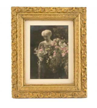 Portrait of Caroline Marcus [John Kauffmann's sister], with Sweet Peas. A vintage hand-coloured gelatin silver photograph (visible image size 198 × 140 mm). John KAUFFMANN.