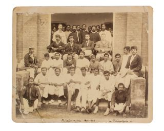 A vintage group photograph captioned 'Cricket Match Feb 02 Furreedpore' ['1902 Faridpur' in another hand on the verso]