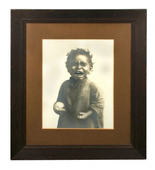A very unusual large-format vintage gelatin silver portrait photograph of a young Indigenous...