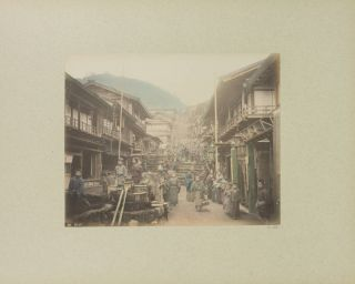 Two impressive large-format albums containing a total of 110 hand-coloured nineteenth-century albumen paper photographs of Japan by Adolfo Farsari