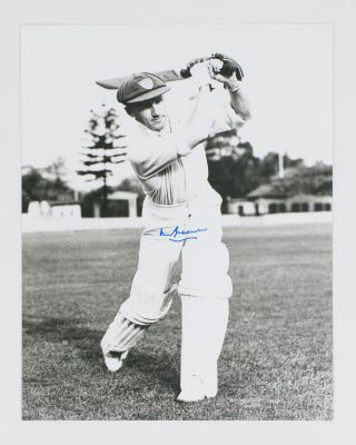 A signed photograph (303 × 240 mm) of Don Bradman executing a straight drive. Cricket, Don BRADMAN