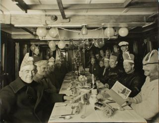 Christmas Dinner on board the SY 'Discovery', 1930. BANZARE, Frank HURLEY