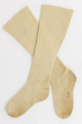 A pair of long cream woollen socks belonging to Douglas Mawson (with his initials in ink on each sole)
