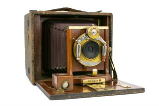 A Rochester Optical Company 4 × 5 Premo B folding plate camera, with burgundy leather bellows, Victor shutter apparatus and three original plate film-holders