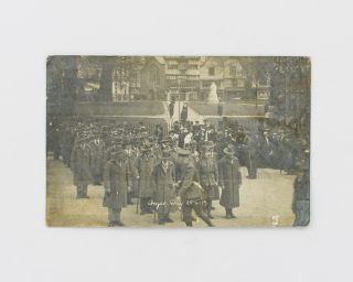 A postcard-format gelatin silver photograph of an Anzac Day commemoration in England in 1917. A...