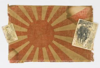 A small Japanese flag (linen, approximately 210 × 310 mm) and two snapshots of Japanese men. One...