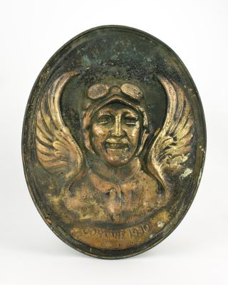 A hand-crafted and possibly unique relief portrait (in pressed and hand-chased brass) of the...