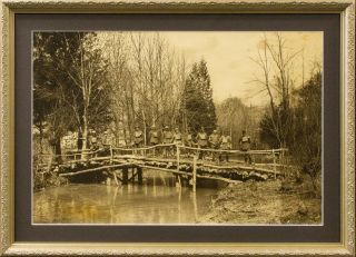 A very large photograph showing a bridge constructed by the 10th Field Company of Australian...
