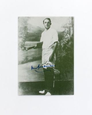 A printed postcard portrait (148 × 105 mm) of Don Bradman, signed in blue ink. Cricket, Don BRADMAN