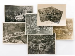 Six aerial photographs (five of them oblique) of identified cities or landmarks in England, five...